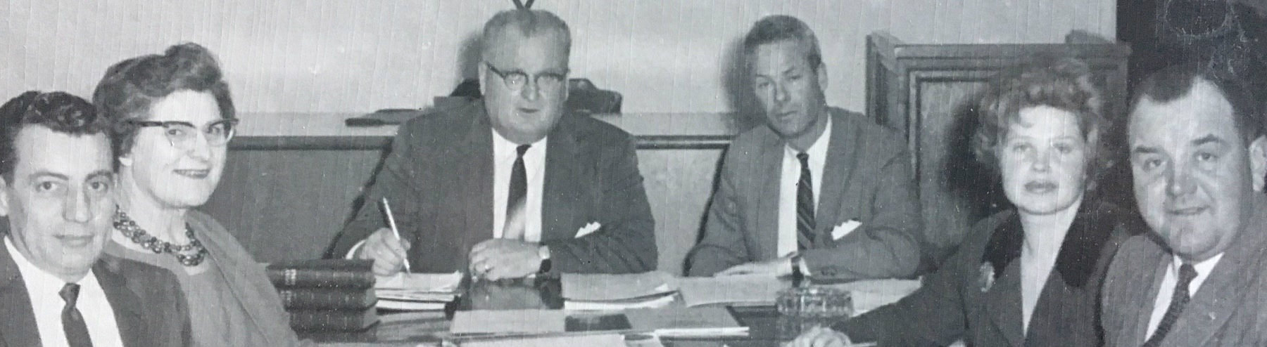 black and white image of reeve and council and clerk (6 people) circa 1966 seated looking at camera