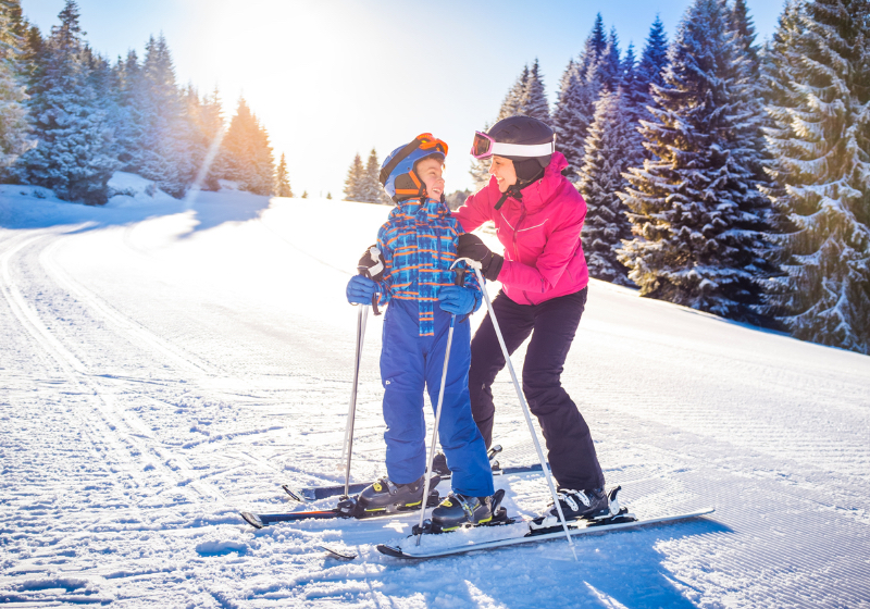 woman and child skiing
