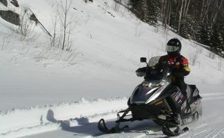 person driving a snowmobile