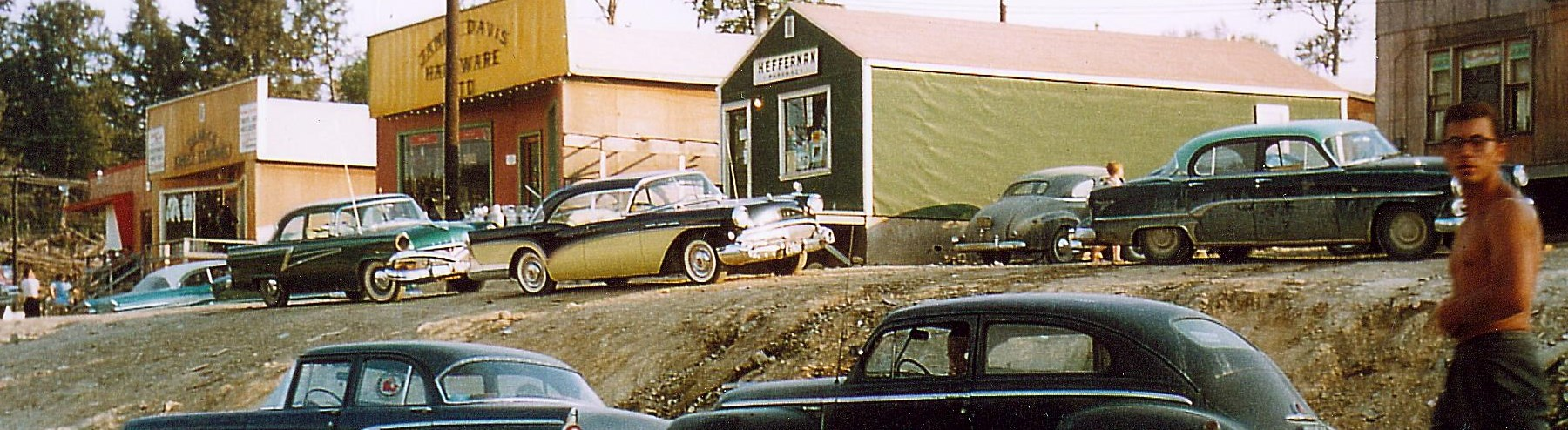 picture of early temporary buildings and cars in elliot lake downtown circa 1956